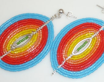 Captivating earrings - silver plated ovals, seed beads, non-tarnish artistic wire, sterling links and posts