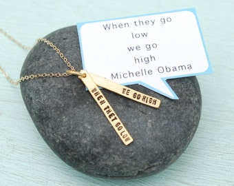 "Michelle Obama Hand stamped quote necklace, ""When they go low, We go high""  14kt gold vermeil charm handcrafted by Chocolate and Steel."