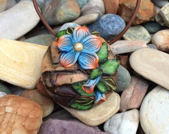 Woodland flowers on faux wood. polymer clay, hand made, wearable art.