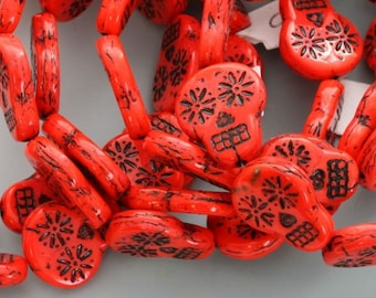 Czech glass sugar skulls. Red with black accents, skull beads, 20mm x 16mm. SOLD BY PAIR. Two beads.