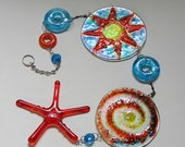 Vibrant sun and swirl dangling glass art suncatcher wall hanging