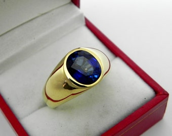 AAAA Blue Sapphire Manmade   10x8mm  3.70 Carats   in  Heavy 14K Yellow gold MAN'S ring 18 grams. 2579
