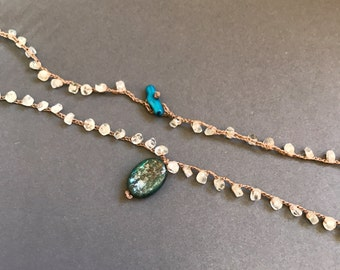 dark kyanite pendant on palest aquamarine strand