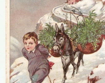 Boy and loaded donkey in snow landscape antique Italian postcard, vintage postcard