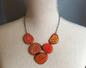 Bib necklace orange with embroidery details Other Colors Avail