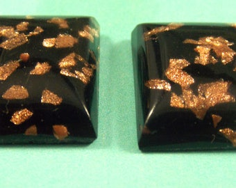18x13mm flat back, cabcohons, Black with a gold flake in them. 2 pcs