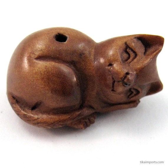 Resting kitty hand carved boxwood ojime bead from