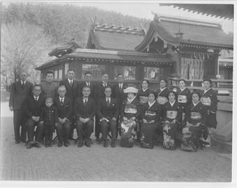 Vintage photo  black and white photo of a group of Japanese people in front of a building