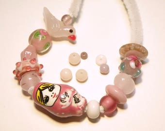 21 Assorted Shapes of Glass and Ceramic Beads: Shades of Pink