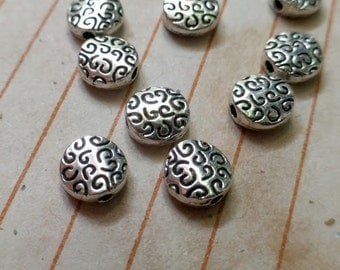 20 disc beads with curly pattern, silver tone, 7mm