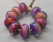 Multicolor encased with clear - 10 handmade lampwork beads