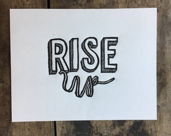 RISE UP   Linoleum print of text on paper