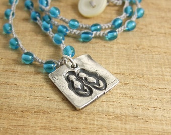 Crocheted Necklace with Light Gray Cord, Turquoise Blue Glass Beads and a Pendant with Flip Flops SN-193
