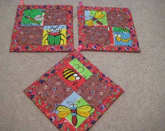 Adorable Garden Insects in Red or Blue Kitchen Potholder Set