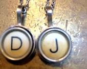 D and J Tuperwriter key pendants