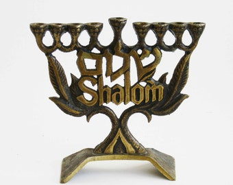 """A vintage solid brass chanukah menorah made by """"Hen-Holon"""",  Israel, signed"""