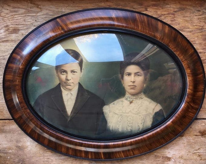Featured listing image: Antique bubble glass portrait of Spanish couple convex oval frame Victorian portrait
