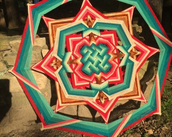 Creating Harmony, a 36 inch Mandala, with a celtic mandala design inlaid in the center, by custom order