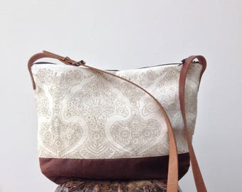Hand printed linen and waxed canvas crossbody day bag with leather handles in Tallulah