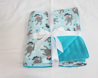 Reversible Sock Monkey & Teal Flannel Baby Blanket - double thickness blanket