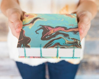 Handmade book with suminagashi marbled papers