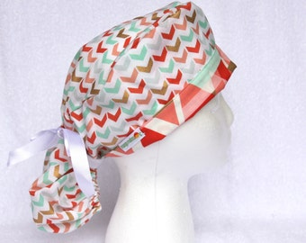PonyTail Scrub Hat - Pony Tail Surgical Hat, Fold up accent fabric, Turquoise, Pink, and Gold Geometric Arrows