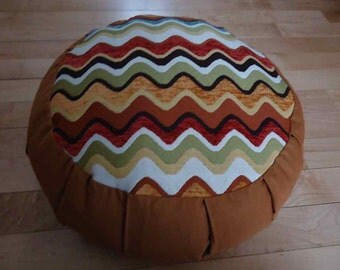 Meditation cushion with chevron zig zag design on top and Safron color sides and back