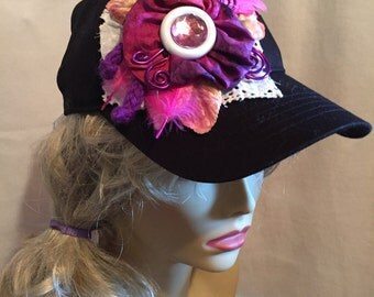 Black Baseball Cap  Decorated with A Collage of Pink and Purple Flowers Feathers and Findings