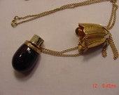 Vintage FULL Avon Charisma Amber Glass Eggplant Perfume Bottle Necklace  16 - 811