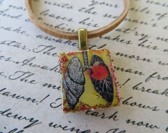 Vintage Look Lung Print Scrabble Tile Pendant With Leather Cord