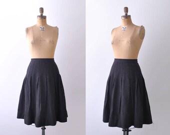 1960's charcoal wool skirt. s. 60 gray skirt. full pleated. gored. dark.