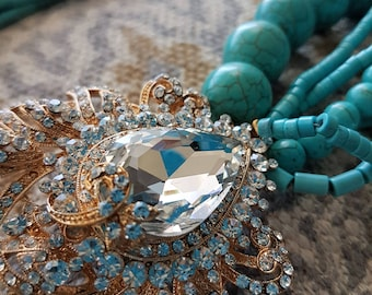 Alta Marea Stones collections turquoise with crystal broch.