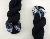 "Rad DK - ""TV Static"" - black yarn with one speckled white end - DK weight superwash merino wool"