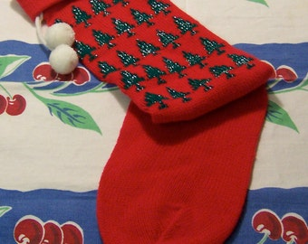 red stocking with trees knit stocking