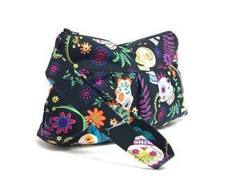 Pleated Wristlet in a Colorful Day of the Dead Sugar Skull Print on a Black Background