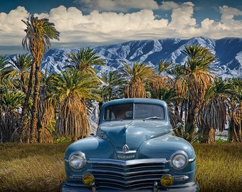 Vintage Blue Plymouth Automobile against Palm Trees and Cloudy Blue Sky near Palm Springs California a Fine Art Landscape Photograph