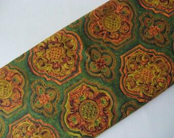 Vintage 70s floral medallion barkcloth print cotton novelty fabric goldy orange on green