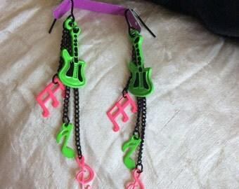 pierced earrings black chains w/pink/green musical motifs guitar treble clef