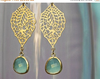 20% off. chandelier Filigree paisley earrings. Gold earrings with framed and faceted sea green drop