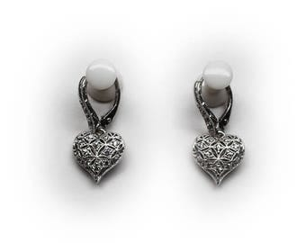 Sterling Silver Filigree Heart Lever-back Earrings accented with Diamond Simulant Crystals