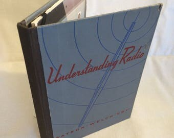 iPad mini case. Made from  recycled materials, 'Understanding Radio'. Cover is actual cloth from an actual book! RECYCLED!