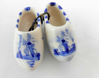 Vintage miniature porcelain wooden shoes from Holland on cord for hanging TINY porcelain shoe ornaments Dutch shoes Holland miniature shoes