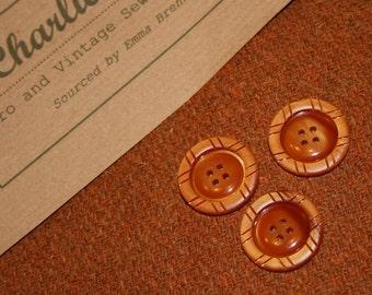 Handwoven Harris Tweed fabric piece in a plain rusty tan shade