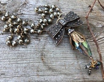 Pyrite gemstone chain & Bow Brooch Necklace.Giant flower Cap and Blue Iolite crystal and Brass shell pendent.The Baroque Princess jewelry
