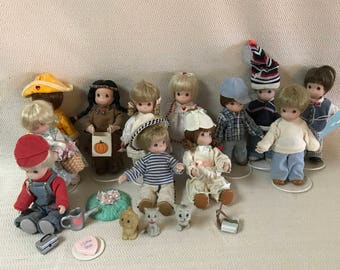 Lot of 12 Precious Moments Dolls and Accessories Porcelain and Cloth