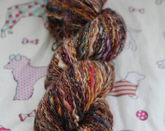 Hand spun yarn, 4ply weight. wool,silk, nylon blend. 90gms