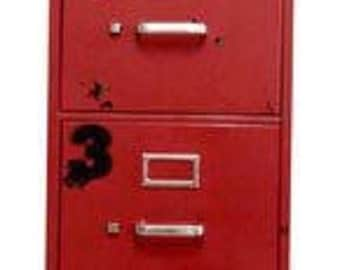 vintage style industrial file cabinet with four drawers in firetruck red