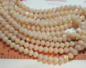 1 strand of 6x4mm Faceted Rondelle Light Salmon Peach Chinese Crystal.
