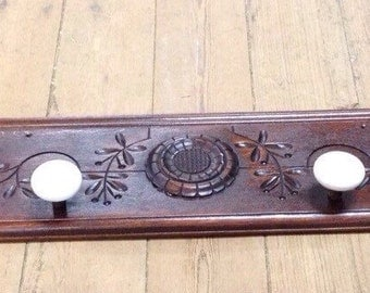 Antique coat rack • antique eastlake wood with antique doorknobs • repurposed reclaimed wood panels