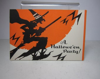 Vintage 1930's unused Hallowe'en party invitation,silhouette of wicked witch riding her broomstick past orange full moon with bats